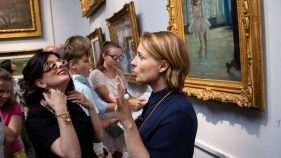 Evgeniya Kiseleva, Head Of Access And Inclusion Department, Leading A Group Of Visitors With Disabilities On A Tour Of the Pushkin State Museum Of Fine Arts Collection. Photo Credit: the Pushkin State Museum Of Fine Arts.